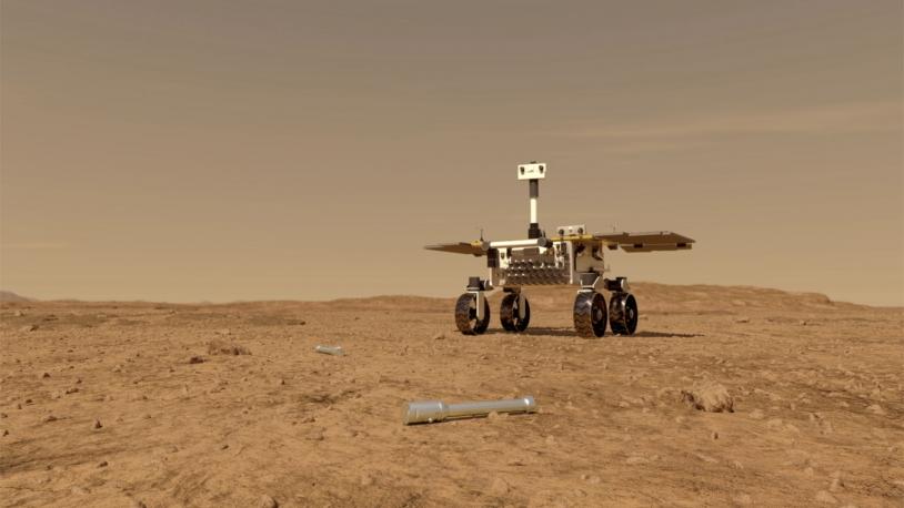 Vue d'artiste du Sample Fetch Rover approchant un échantillon sur le sol martien